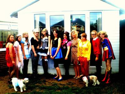 All of us in costume, outside the shed.