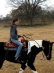 One of my friends, Keira, on my mom's horse Satin!