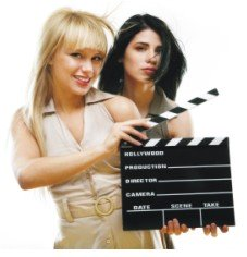 pretty girls holding clapboard