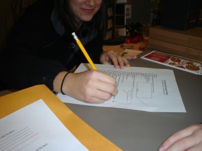 A Store Clerk Signing the Scavenger Hunt List