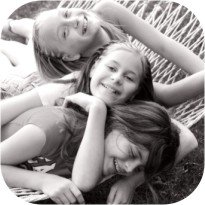 young girls laughing on hammock
