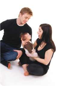 couple holding baby
